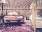 King bed and double bunk in Yurt Bronwyn