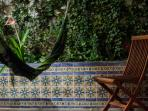 Hammock in courtyard among our hand painted Spanish tile