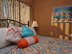 Belleair Beach Club 201 features a King size bed  and tropical style