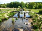 Visit the ancient clapper bridge at Postbridge