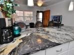 Stunning granite in the updated kitchen at HBHN25 with plenty of space to cook