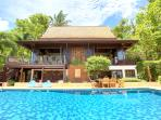 The main building: poolside with kitchen, lounge, dining and bar areas
