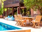 Plenty of seating and lounging areas poolside