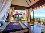 Master en-suite Bedroom 1 - spacious with stunning ocean / sunset views
