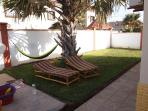Spacious, private back yard with a big palm tree providing shade