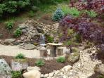 Incredibly landscaped side yard with waterfall and fire pit.