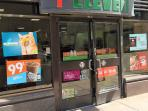 24 hour 7-Eleven around side of building