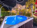 In the garden area among spectacular flowers there is an outdoor Hot tub - Jacuzzi