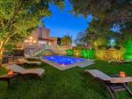 Swimming pool and garden area at night