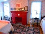 Bedroom 4: Two singles, an ornamental fireplace & water views.