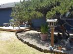 front yard rock garden with ocean view deck