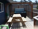 Ocean view deck with hot tub and deck furniture