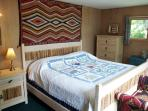 Master bedroom features a beautiful view of Squaw Lake