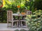 Beatiful dining sala set amongst lush tropical gardens overlooking the pool