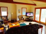 Great Room! Larger Flat Screen TV! Adjoining Kitchenette. Access to Deck, BBQ & Screened Porch.