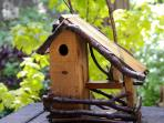 BIRD HOUSE ON TOP OF OLD GRADMA'S BIRD FEEDER