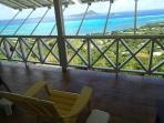 The verandah has 6 Adirondack chairs and a hammock (not seen here) n