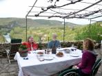 dinner on terrace (spring before luxuriant grape arbor fills in)