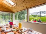 Breakfast or evening meal in the sunroom perhaps?