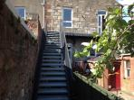 Stairs from back leading to garden