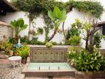 The large, central courtyard has  lots of seating, beautiful plants and a great fountain.
