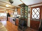 Fully equipped kitchen with bay views, stainless steel counter tops and appliances and a breakfast bar for two.
