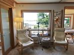 Living room with spectacular bay views, flat screen TV/VCR/DVD, leather furniture, custom lighting and large picture...