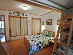 Third bedroom with a Double bed, two Twin/Double bunk beds and TV/VCR/DVD; privacy curtain separating the double bed...