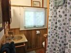 Hall bathroom by third bedroom with shower stall.