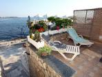 Private sun deck with deckchairs for sunbathing and relaxing