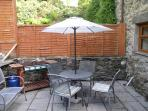 Eat ElFresco in the Back Garden Terrace BBQ patio area