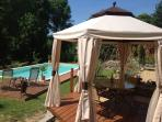 Large Pool area with Pergola for shade and ample sun loungers for all the family, private & tranquil