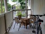 Large covered porch with table for playing games or enjoying cocktails