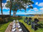 Garden Dining with old slate table, BBQS, Views of Bay and Angel Mountain