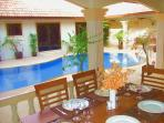 AL-FRESCO DINING OVERLOOKING THE POOL AND COURTYARD