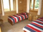 Large bedroom with two single beds or one double bed