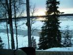 Winter ice is melting on Kasilof River