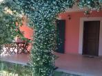 entrance and  porticato front  garden