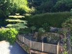 Upper garden with views, seating, table and BBQ