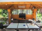 wooden pavillon, with lounge, seats & table, tv, homecinema 5.1, Apple TV2
