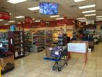 Various grocery items, beverages, vegetables, meat market, ice, and other.