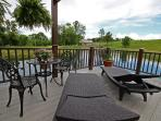 10x16 dock on water with Wifi,Trellis system, dining set, and lounge chairs