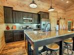 Spacious Gourmet Kitchen. Wine openers, dishwasher, Fridge, Large Granite Island