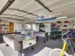 Game Room with foosball, air hockey tables, and cruiser bikes