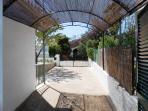 Bamboo shade and driveway