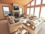 Living room with floor to ceiling picture windows providing spectacular ocean views, wall mounted flat screen cable...