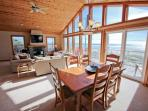 Dining table for six with spectacular ocean views and a slider leading to upper deck.