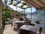 Lakeside terrace of restaurant Grotto di Pescatori in Lezzeno.