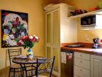 A sunlight filled kitchenette, with Diego artwork that adds to the Mexican atmosphere