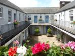 Trinity Mews - an historic Grade 2 Listed courtyard building near Torquay Harbour (no. 16 top right)
